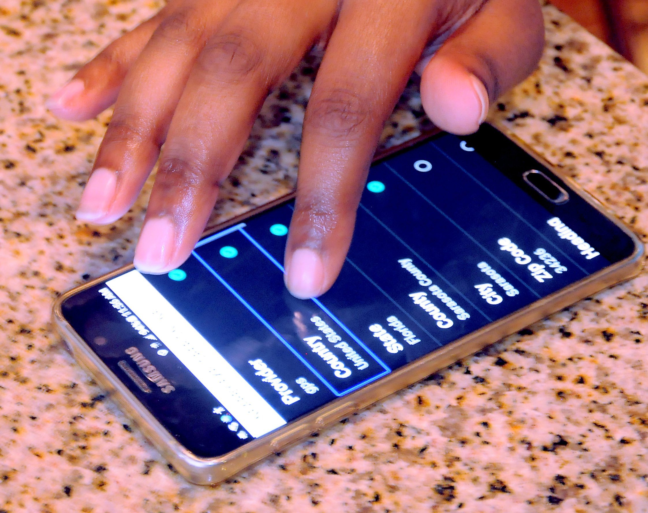 Closeup of user interacting with mobile device