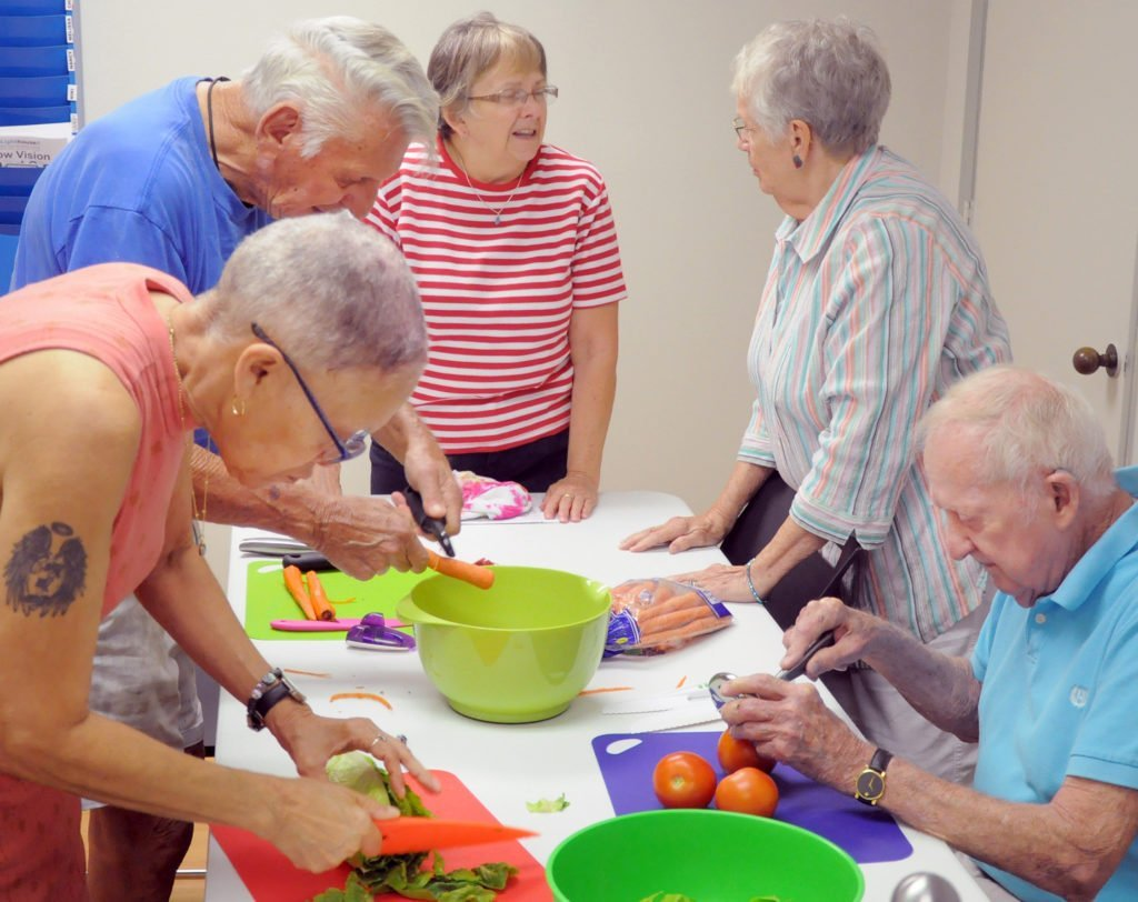 a-group-of-five-older-adults-cooking