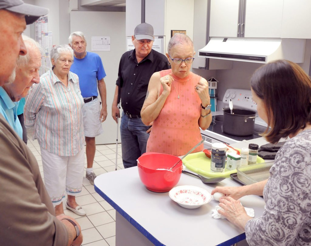 group-of-adults-watching-a-cooking-demonstration
