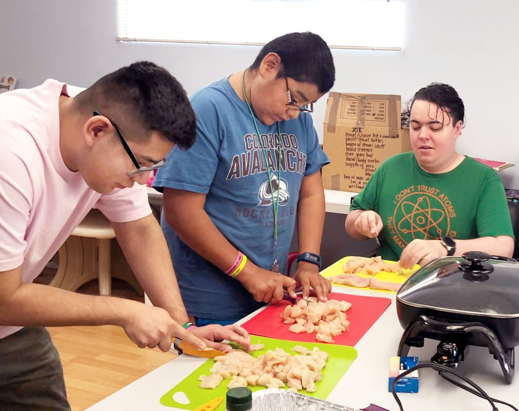 three-young-adults-cooking