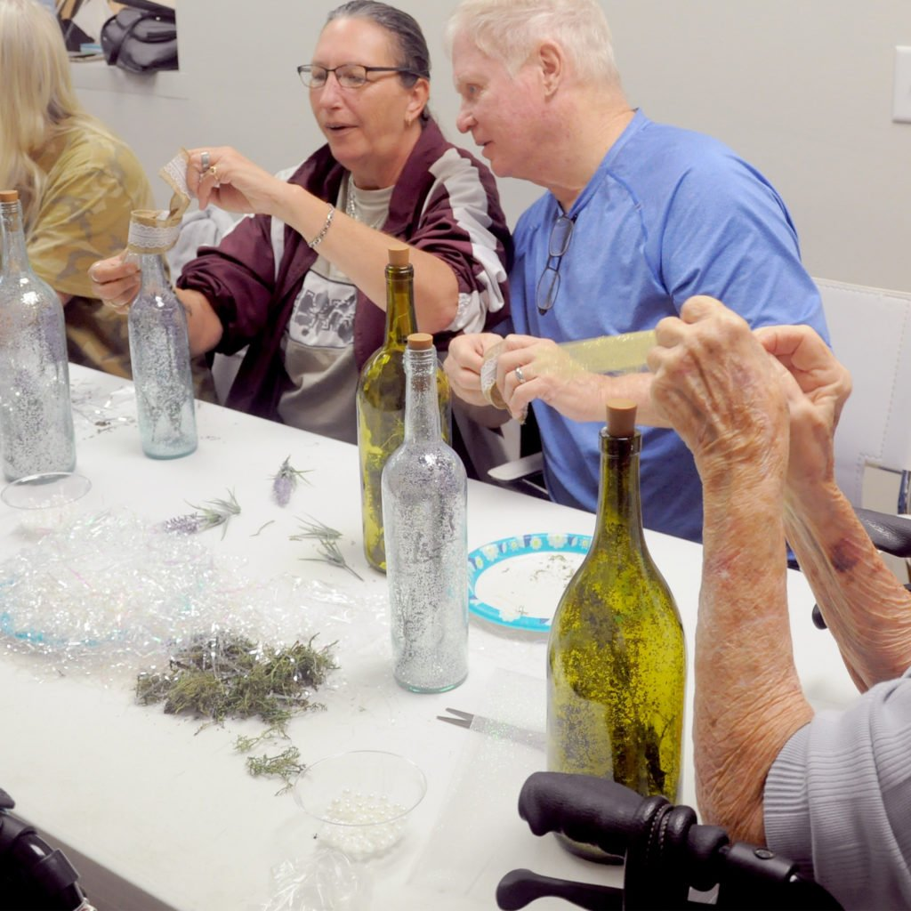 woman-and-man-doing-crafts-with-bottles