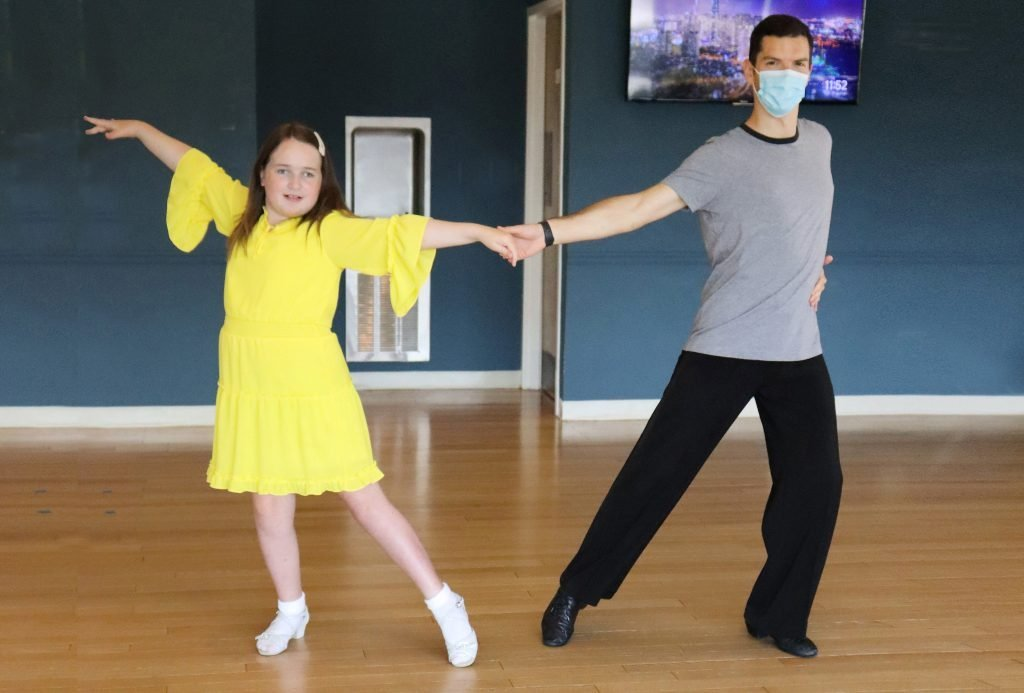 Millie takes ballroom dance lessons