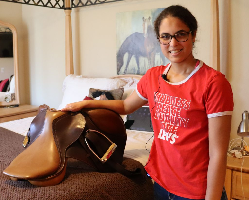 Brianna showing her horse saddle