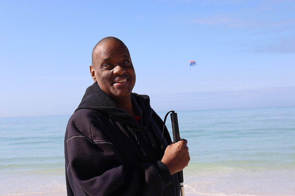 Ray smiling at the beach