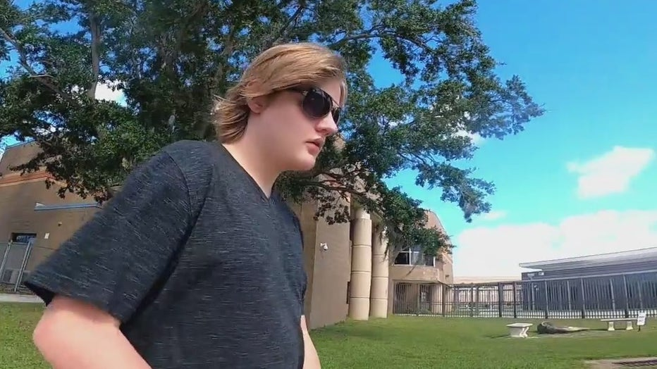 Levi walking on the campus of Booker High School